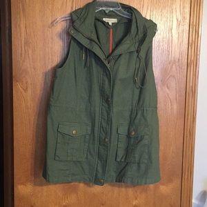 Olive colored cargo vest